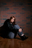 Bored looking teenage girl sitting Stock Image