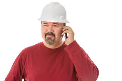 Bored looking workman chatting on his mobile Royalty Free Stock Photo