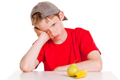Bored male child with fruit Royalty Free Stock Photo