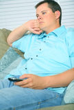 Bored Male Holding TV Remote Royalty Free Stock Photos