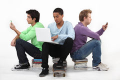 Teenagers sat together Royalty Free Stock Photo