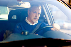 Bored man driving his car Stock Images