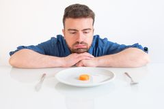 Bored man eating only low calorie lunch for diet Stock Photo