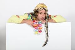 Bored man in hippie costume Stock Photos