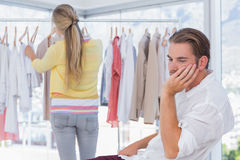 Bored man while his girlfriend is shopping Royalty Free Stock Photography