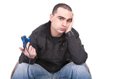 Bored man with a joystick for game console Stock Photo