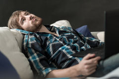 Bored man with a laptop Stock Image