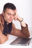 Bored man with laptop Stock Photos