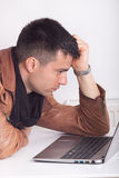 Bored man with laptop Royalty Free Stock Photo