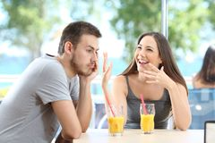 Bored man listening her friend talking royalty free stock image