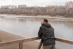 Bored man looking at the river Royalty Free Stock Photos