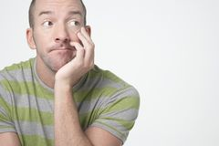 Bored Man Looking Sideways. Over white background Royalty Free Stock Photos