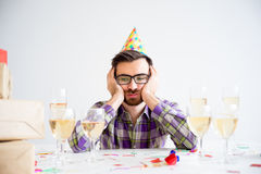 Bored man at party. Bored man is alone at a birthday party Stock Photos
