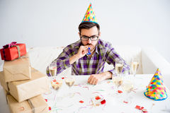 Bored man at party. Bored man is alone at a birthday party Royalty Free Stock Photo
