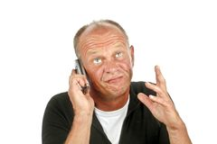 Bored man on the phone Royalty Free Stock Photo