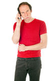 Bored man on phone Stock Image