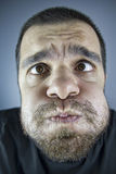 Bored Man. Portrait of boredom man close-up face Royalty Free Stock Photo