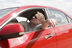 Bored man in red car Stock Photography