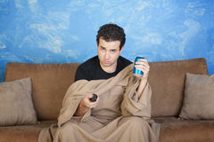 Bored Man With Remote Control Stock Photos