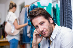 Bored man sitting in front of his girlfriend Stock Photos