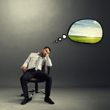 Bored man thinking about rest Royalty Free Stock Photography