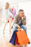 Bored man waiting for his shopping woman Royalty Free Stock Photo