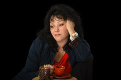 Bored mature woman drinking coffee Royalty Free Stock Photo