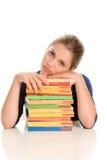 Bored meisje met boeken Stock Foto's