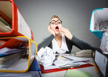 Bored office employee at work. Paperwork job corporation lazy slow boring concept. Bored office employee at work. Female nerdy bureau clerk at desk Stock Image