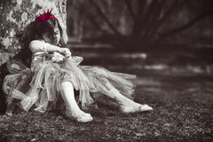 Bored princess. Sad and lonely little girl with pink crown Stock Image