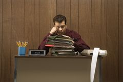 Bored retro businessman in office. Royalty Free Stock Photography