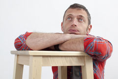 Bored 40s man with casual body language expressing fatigue Royalty Free Stock Photography
