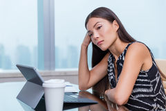 Bored sad tired woman working at boring office job. Bored or sad woman working at office job. Negative work concept. Tired businesswoman sitting at desk in front Stock Photo