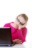 Bored, sad woman sitting in front of laptop. Stock Photo