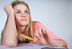 Bored scandinavian cute young girl looking for inspiration  when Royalty Free Stock Image