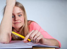 Bored scandinavian cute young girl looking for inspiration  when Royalty Free Stock Photos