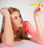 Bored scandinavian cute young girl looking for inspiration  when Royalty Free Stock Photo