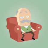 Bored senior sitting in his armchair Royalty Free Stock Photos