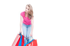Bored shopaholic carrying her heavy bags with buyings. With advertising area isolated on white background royalty free stock images