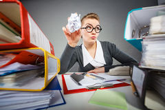 Bored sleepy businesswoman in office. Royalty Free Stock Photos