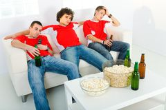 Bored sport fan royalty free stock image