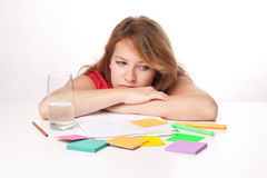 Bored student. Bored college student is having a rest during studying for exam Royalty Free Stock Images