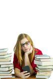 Bored student on a cellphone Royalty Free Stock Image