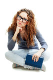 Bored student girl holding book Royalty Free Stock Photos
