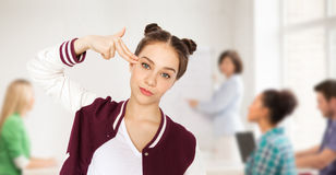 Free Bored Student Girl Making Finger Gun Gesture Stock Photography - 65709912