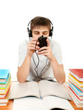 Bored Student in Headphones. With the Books on the White Background Royalty Free Stock Image