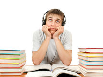 Bored Student in Headphones. With the Books on the White Background Royalty Free Stock Images