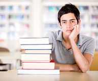 Bored student at the library Stock Images