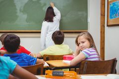Bored student looking away from board. At the elementary school Royalty Free Stock Photography