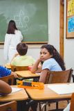 Bored student looking away from board. At the elementary school Royalty Free Stock Images
